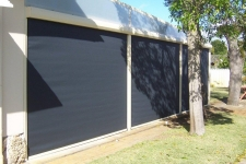 2 Ziptrak outdoor blinds with pelmets viewed from the outside looking in.