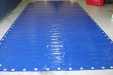 Custom made pvc tarp with large eyelets, tarps can be made to suit customer requirements.